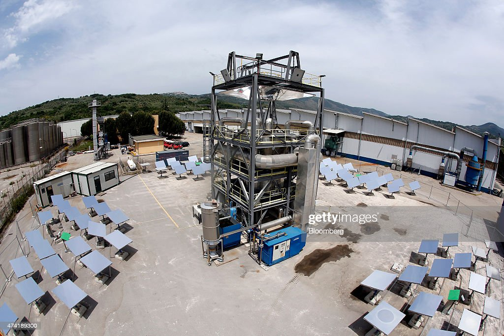 Heliostat panels surround a solar generation unit at a Solar Thermoelectric Magaldi (STEM) pilot plant, operated by Magaldi Group, in Buccino, Italy, on Monday, May 18, 2015. The project captures the energy of the sun which is transferred via the generation unit to heat retaining silica sand, producing steam that powers a turbine and is suitable for use in systems operating over a large temperature range. Photographer: Alessia Pierdomenico/Bloomberg via Getty Images