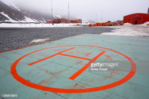 a helipad at base orcadas which is an argentine scientific station in antarctica - south orkney island stock pictures, royalty-free photos & images