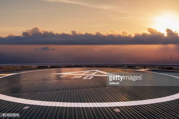 helipad beyond the clouds - helipad stock photos and pictures