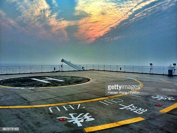 Helipad By Sea Against Sky During Sunset
