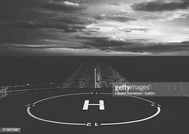 Helipad On Ship In Sea Against Cloudy Sky At Dusk