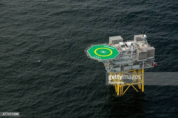 A helipad sits on top of a transformer sub station in the North Sea as installation and construction continues at Amrumbank West offshore wind park...