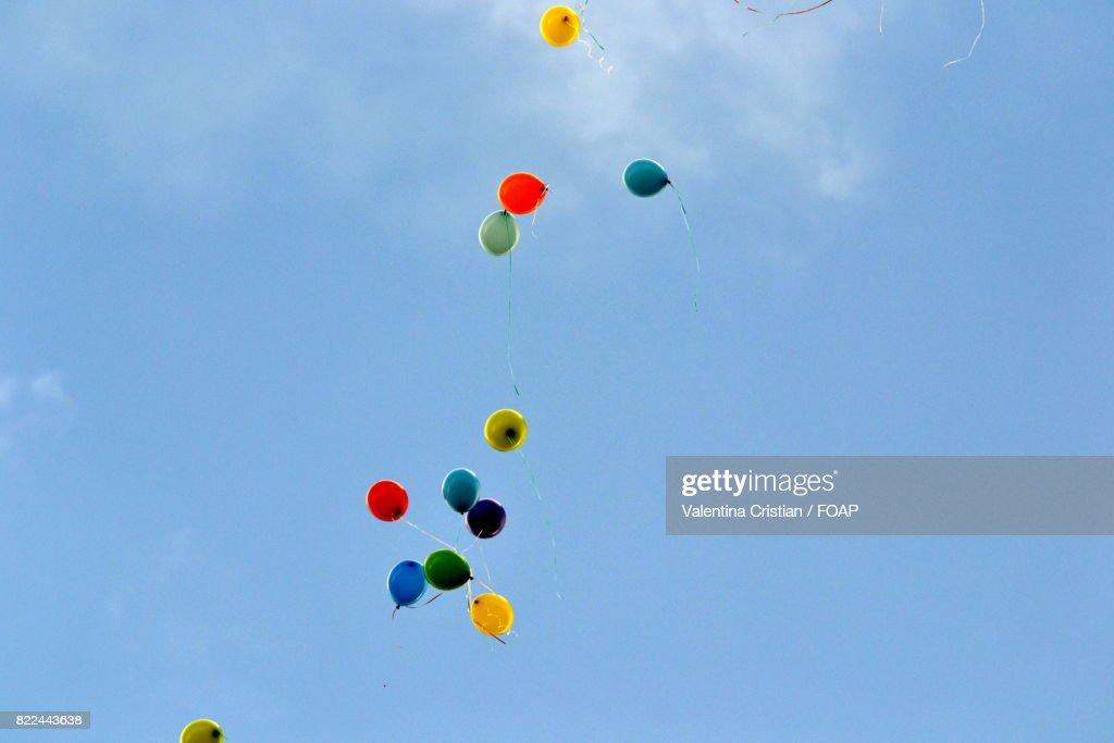 Helium balloons in sky : Stock Photo