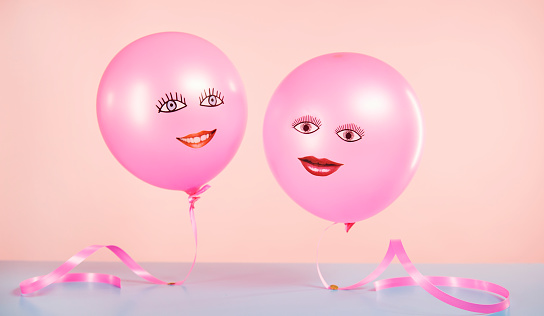 helium balloons with smiling faces floating - gettyimageskorea