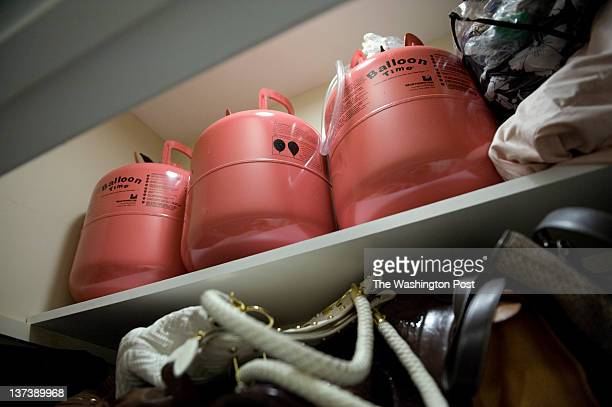Helium tanks are seen in a closet at the home of June Lennon on Tuesday September 20 2011 in Bayonne NJ Lennon has consulted Dr Lawrence Egbert about...