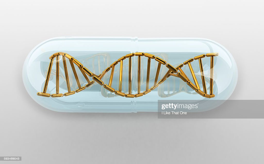 DNA Helix held within a clear medication capsule : Stock Photo