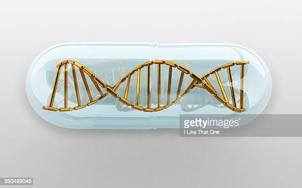 dna helix held within a clear medication capsule - atomic imagery stock pictures, royalty-free photos & images
