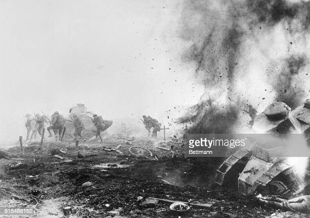 Hell breaks loose in Flanders... One of the most graphic of all war pictures. This photograph of actual combat shows a British tank being wrecked by...