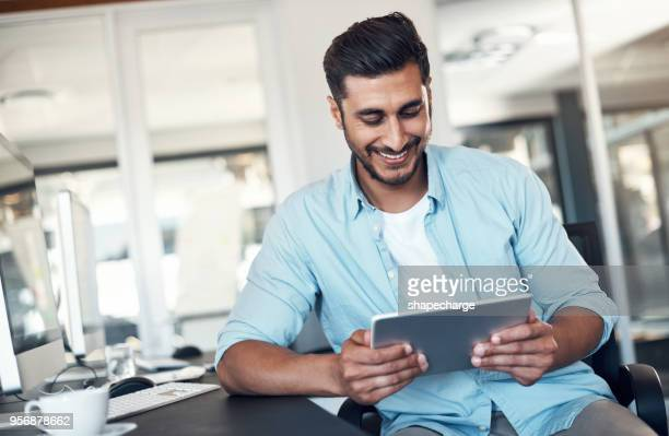 he'll get it done in digital format - using digital tablet stock photos and pictures