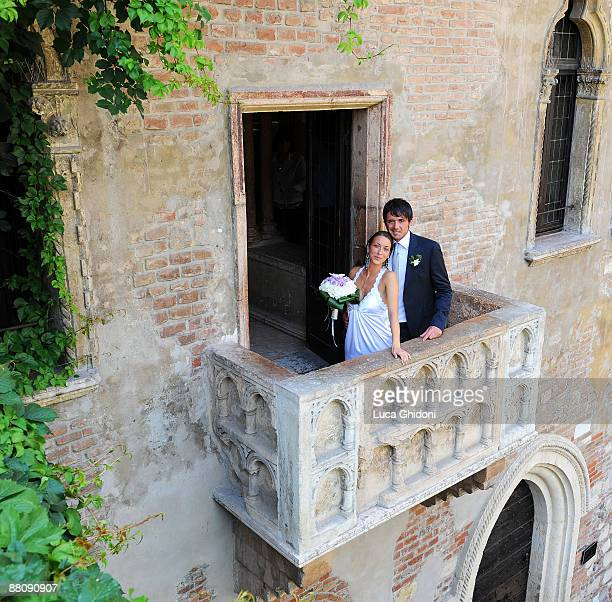 Hellas Verona football player Luca Ceccarelli and his wife Irene Lanforti pose on Romeo and Juliet balcony on June 1 2009 in Verona Italy This is the...