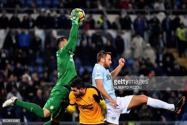 Hellas Verona's Brazilian goalkeeper Nicolas Andrade vies with Lazio's defender from Nederlands Stefan de Vrij during the Italian Serie A football...