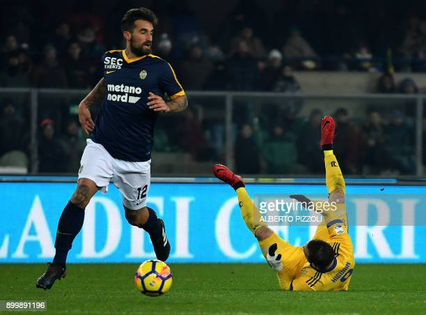 Hellas Verona's Italian defender Antonio Caracciolo fights for the ball with Juventus's forward from France Gonzalo Higuain during the Italian Serie...