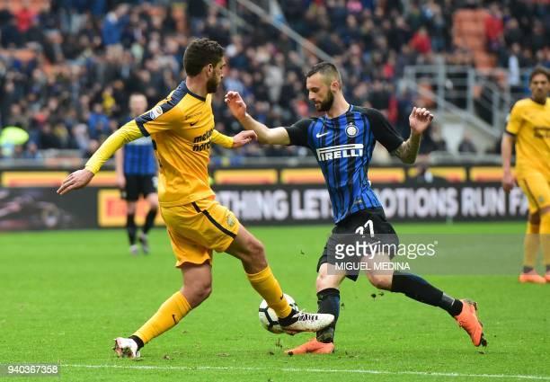 Hellas Verona's Italian defender Antonio Caracciolo vies with Inter Milan's Croatian midfielder Marcelo Brozovic during the Italian Serie A football...