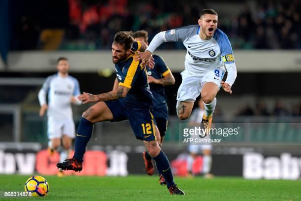 Hellas Verona's Italian defenderr Antonio Caracciolo vies with Inter Milan's Captain Argentinian captain and forward Mauro Icardi during the Italian...