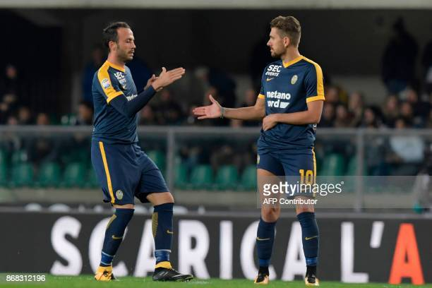Hellas Verona's Italian forward Giampaolo Pazzini celebrates with Hellas Verona's Italian forward Alessio Cerci after scoring a penalty kick during...