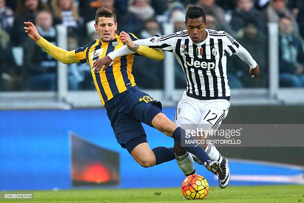 TOPSHOT Hellas Verona's midfielder Pawel Wszolek from Poland fights for the ball with Juventus' defender Alex Sandro from Brazil during the Italian...