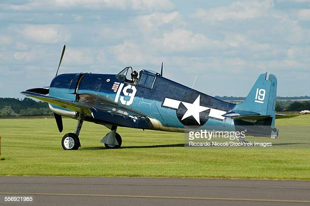 F6F Hellcat in World War II U.S. Navy colors while taxiing at Duxford airport, England.
