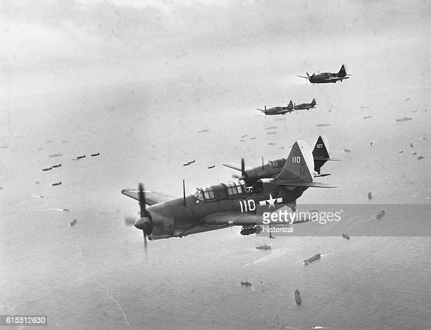 Helldiver aircraft from carriers of Task Force 58 are on their way to support Marines assaulting Iwo Jima in the Volcano Islands Ca FebruaryMarch...
