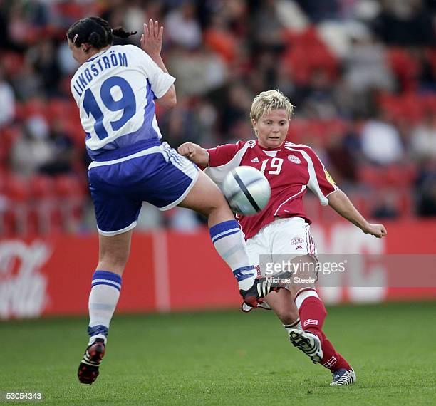 Helle Nielsen of Denmark shoots past Heidi Lindstrom of Finland during the Women's UEFA European Championship 2005 Group A match between Finland and...