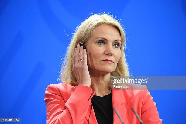 Helle ThorningSchmidt Denmark's prime minister listens via an earpiece during a news conference at the Chancellery in Berlin Germany on Thursday June...