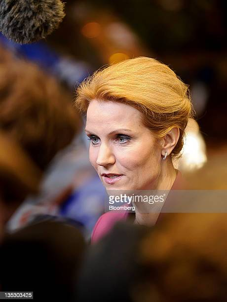 Helle ThorningSchmidt Denmark's prime minister speaks to the media while arrivingto attend a working dinner as part of a twoday summit of European...