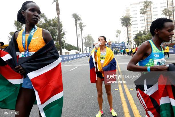 Hellen Jepkurgat from Kenya from left winner of the women's division of the 32nd annual Los Angeles Marathon stands with Angela Orjuela of Columbia...