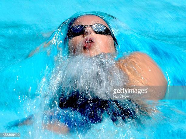 Hellen Moffitt swims in the Women's 100 Meter Backstroke Prelims during the 2014 Phillips 66 National Championships at the Woollett Aquatic Center on...