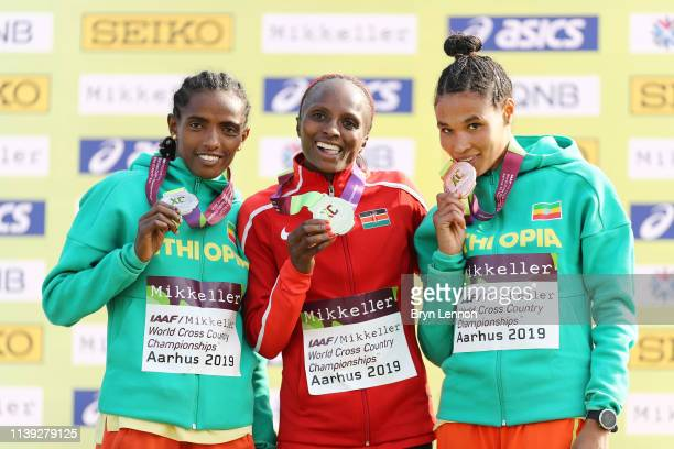 Hellen Obiri of Kenya and Dera Dida and Letesenbet Gidey of Ethiopia pose with their medals after the Womens Senior Final during the IAAF World...