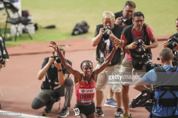 Hellen Obiri of Kenya celebrates after winning the women's 5000m final race at the IAAF World Athletics Championships 2019 at the Khalifa Stadium in...