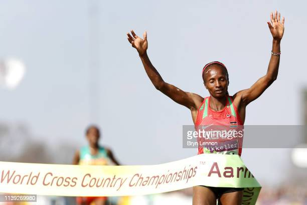 Hellen Obiri of Kenya crosses the line to win the Women's Senior Final during the IAAF World Athletics Cross Country Championships on March 30 2019...