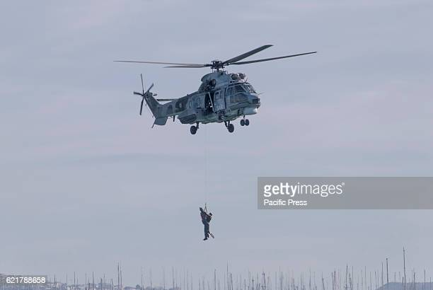 BAY FALIRON PIRAEUS ATTIKA GREECE Hellenic Air Force AS332 Super Puma SAR helicopter collects a Hellenic Navy' s Navy Seals Underwater Demolition...