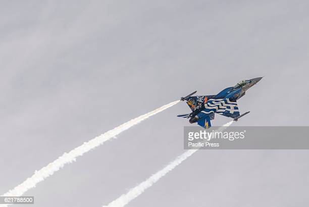 BAY FALIRON PIRAEUS ATTIKA GREECE Hellenic Air Force F16 block 52 Fighting Falcon of 'Zeus' team flies over Flisvos bay during the Air Show of...