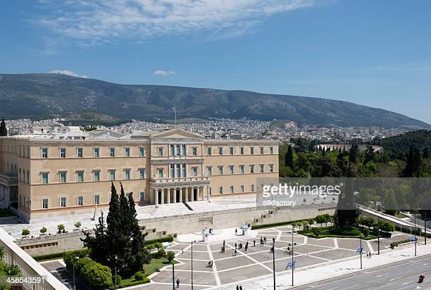 hellenic parliament building and syntagma square in athens in greece - greek parliament stock pictures, royalty-free photos & images