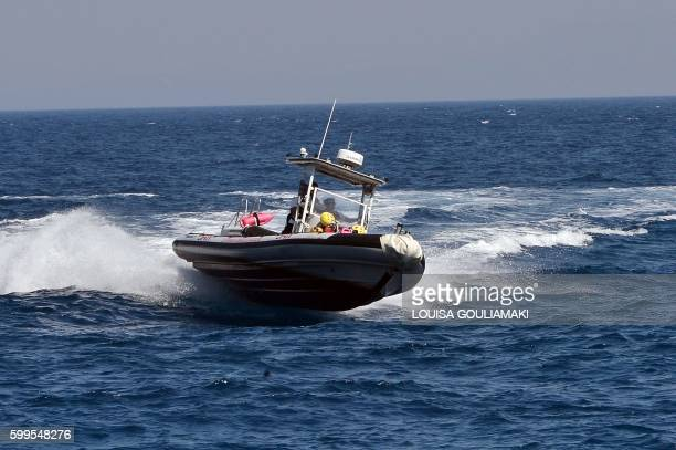 Hellenic Rescue Team members take part in an exercise on a boat on the Greek island of Samos on September 1 2016 Hellenic Rescue Team and Efi...