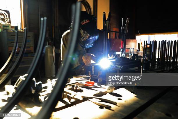 Hellgate Forge Fabricator and Welder Troy Bloom welds handmade fixtures at the company's shop inside the former lumber mill's 100yearold machine shop...