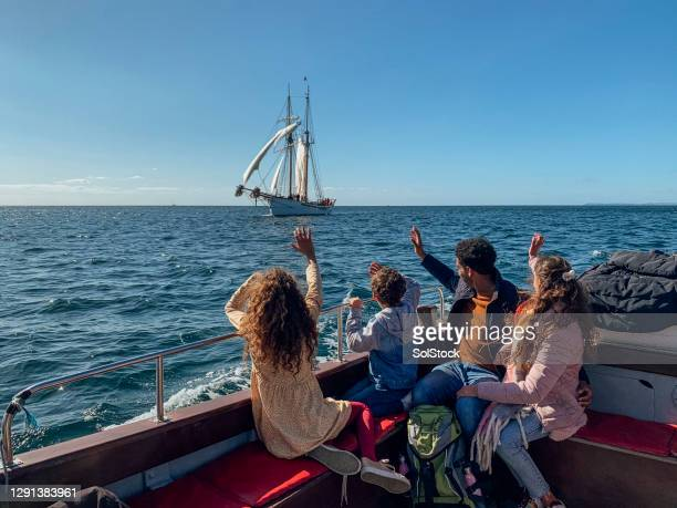 hello from our boat to yours - waving stock pictures, royalty-free photos & images