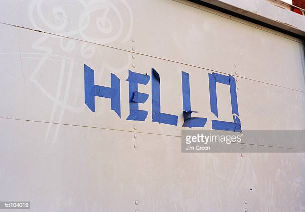 hello in adhesive tape on a wall - single word stock pictures, royalty-free photos & images