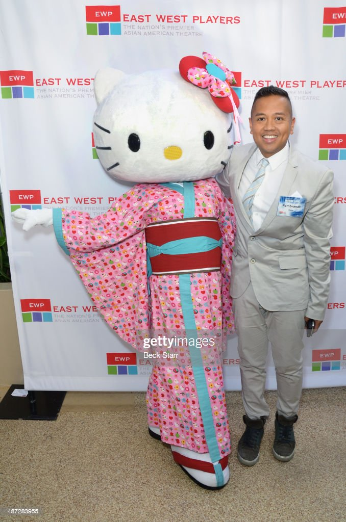 Hello Kitty and public relations executive Rembrandt Flores arrives at Making Light East West Players 48th Anniversary Visionary Awards at Hilton Universal City on April 28, 2014 in Universal City, California.