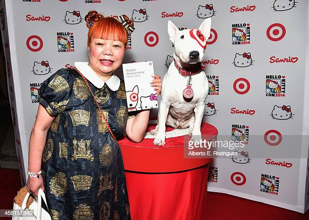 Hello Kitty designer Yuko Yamaguchi poses with Bullseye the Target dog at Hello Kitty Con 2014 Opening Night Party Cohosted by Target on October 29...
