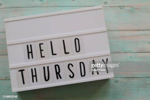 """""""hello thursday"""" message in light box - thursday stock pictures, royalty-free photos & images"""