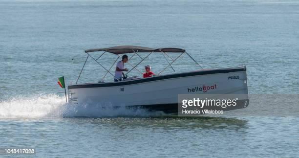 A 'helloBoat Lisboa' water taxi motorboat sails on the Tagus River near 25 de Abril bridge on October 01 2018 in Lisbon Portugal 'helloBoat Lisboa'...