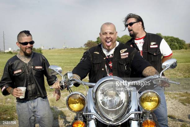Hells Angels motorcycle club member Monster shows off his Indian motorcycle to club members Big Lou and Bone during a Hells Angels rally July 26 2003...