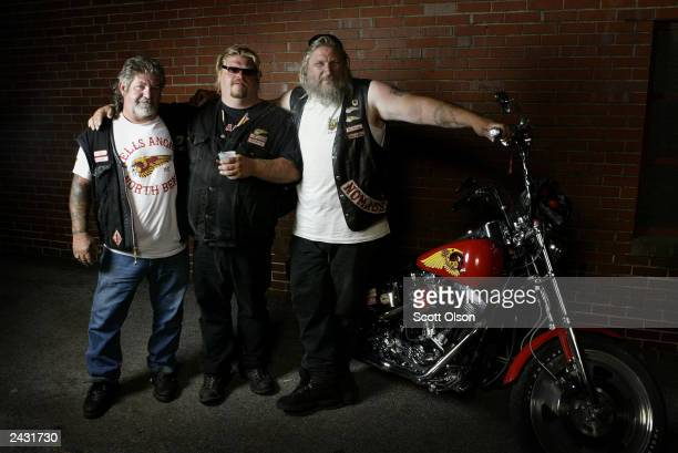 Hells Angels motorcycle club members Moses Ricky and Roger stand together as they attend a party August 23 2003 in Quincy Illinois The party was...