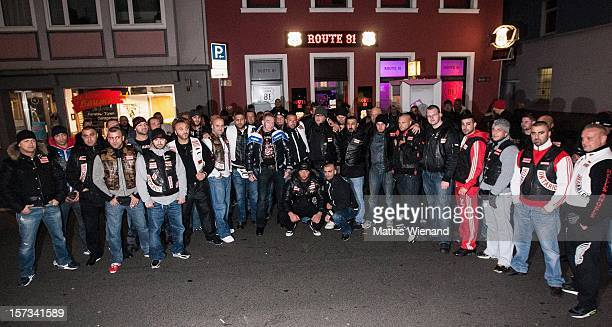 Hells Angels pose after the head of the 'West Central' chapter of the Hells Angels Christian Mueller spoke to media following the defection of 30...