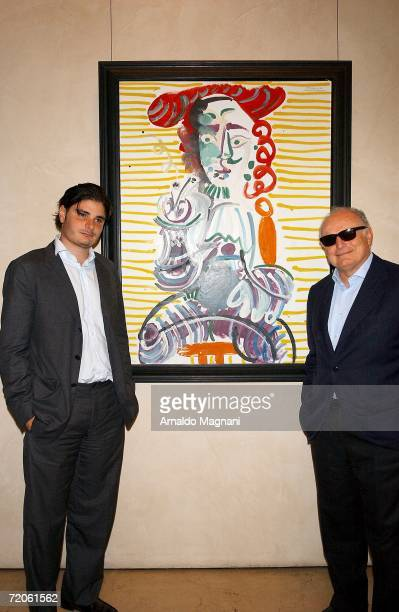 Helly Nahmad and David Nahmad pose in front of a Picasso painting at the Helly Nahmed Gallery in the Carlysle Hotel on October 1 2006 in New York City