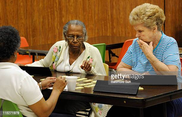 helma Knight from left and Jean King play a game as seniors meet for socializing and discussing Social Security during an event at the Allen Senior...
