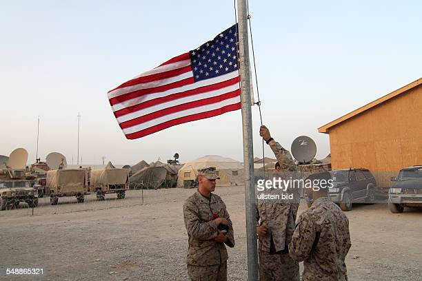 Helmand Camp Bastion of the US army lowering the US national flag