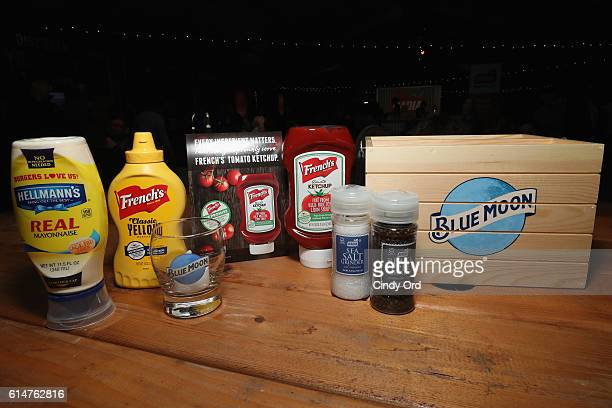 Helmann's Mayonaise, French's Mustard and Ketchup and Badia Spices' salt and pepper and a Blue Moon glass on display at the Blue Moon Burger Bash...