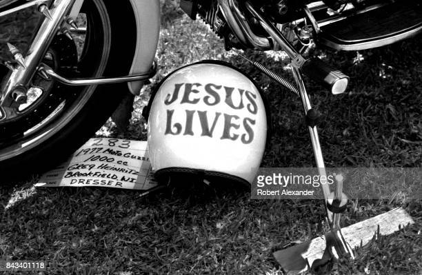A helmet and motorcycle on display at a customized motorcycle show in Daytona Beach Florida during the city's 1983 Bike Week The annual motorcycle...