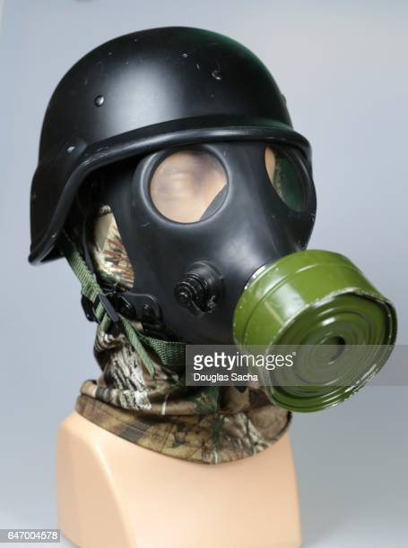 swat helmet and protective gas mask - military uniform stock pictures, royalty-free photos & images